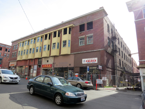 View of the north and west facades of the historic Louisa Building in the Chinatown-International District. A Christmas Eve 2013 fire burned the western half of the building.